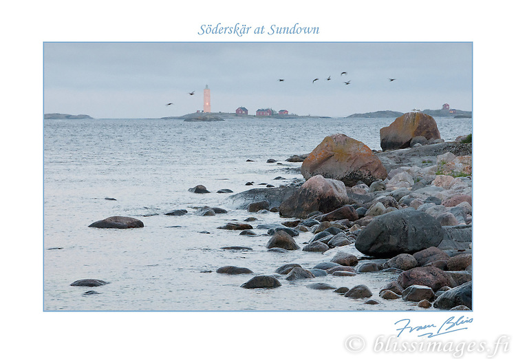Birds fly past Söderskär Lighthouse at sundown in the Gulf of Finland, east of Helsinki.