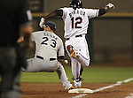 Reno Aces' Angel Berroa makes is safely to first after Tuscon Padres first baseman Matt Clark can't come up with the throw during a minor league baseball game in Reno, Nev., on Saturday, Sept. 3, 2011. The Padres won 6-5 in 11 innings..Photo by Cathleen Allison