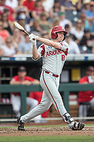 Arkansas Razorbacks outfielder Heston Kjerstad (18) follows through on his swing during Game 5 of the NCAA College World Series against the Texas Tech Red Raiders on June 17, 2019 at TD Ameritrade Park in Omaha, Nebraska. Texas Tech defeated Arkansas 5-4. (Andrew Woolley/Four Seam Images)
