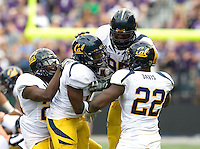Cecil Whiteside of California gets celebrated by California defenders after Whiteside sacked Washington quarterback Keith Price caused him to fumble the ball during the game at Seattle, Washington on September 24th, 2011.  Washington defeated California 31-23.