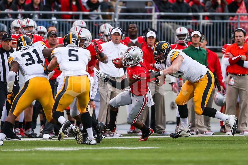 Ohio State Buckeyes running back Dontre Wilson (1) is knocked out of bounds during Saturday's game in Columbus, Ohio on Saturday, Oct. 19, 2013. (Jabin Botsford / The Columbus Dispatch)