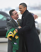Green Bay mayor Jim Schmitt (L) greets United States President Barack Obama as he arrives at Austin Straubel International Airport in Green Bay, Wisconsin on Wednesday, January 26, 2011. President Obama, Vice President Joe Biden and other members of the President's Cabinet traveled across the country Wednesday to highlight the administration's efforts to rebuild the American economy.     .Credit: Brian Kersey / Pool via CNP