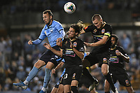1st November 2019; Leichhardt Oval, Sydney, New South Wales, Australia; A League Football, Sydney Football Club versus Newcastle Jets; Adam le Fondre of Sydney, Matthew Ridenton and Nigel Boogaard of Newcastle Jets compete for the header from a corner kick - Editorial Use