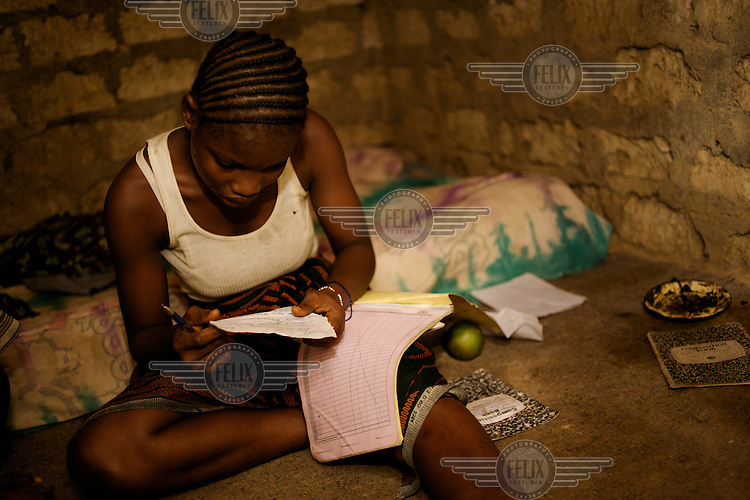 Florence Kaneh doing her homework after school in Volloblai.