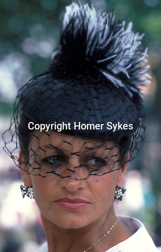 Ladies Day Royal Ascot horse races. Berkshire Cira 1985. Fashionable hat with veil.
