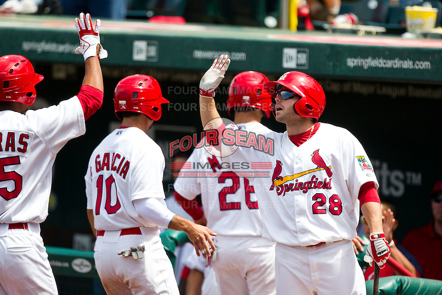 Chris Swauger (28) of the Springfield Cardinals high fives teammates during a game against the Arkansas Travelers at Hammons Field on May 8, 2012 in Springfield, Missouri. (David Welker/ Four Seam Images).