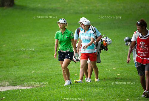 (L-R) Momoko Ueda, Mika Miyazato (JPN),.MARCH 3, 2013 - Golf :.Momoko Ueda and Mika Miyazato of Japan walk with their caddie during the final round of the the HSBC Women's Champions golf tournament at Sentosa Golf Club in Singapore. (Photo by Haruhiko Otsuka/AFLO)