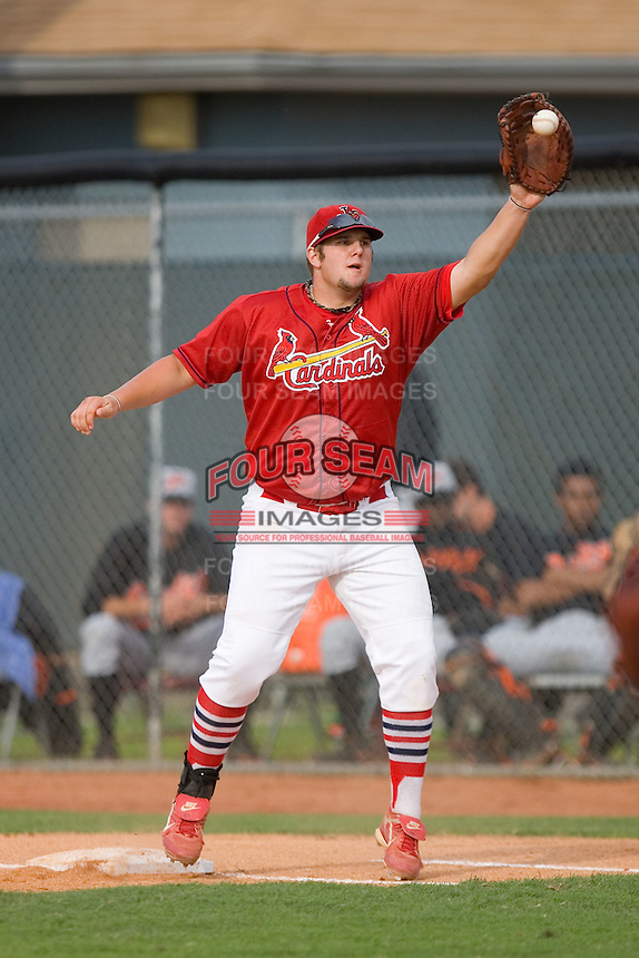Matthew Adams of the Johnson City Cardinals has to come off the bag to field a throw versus the Bluefield Orioles at Howard Johnson Field August 1, 2009 in Johnson City, Tennessee. (Photo by Brian Westerholt / Four Seam Images)