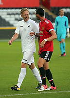 Pictured L-R: Garry Monk with a Manchester United player. Wednesday 09 August 2017<br /> Re: Alan Tate Testimonial Match, Swansea City Legends v Manchester United Legends at the Liberty Stadium, Swansea, Wales, UK