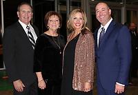 NWA Democrat-Gazette/CARIN SCHOPPMEYER Jim and Rhonda Woodruff (from left) and Meredith and Patrick Woodruff enjoy Art of Hospice.