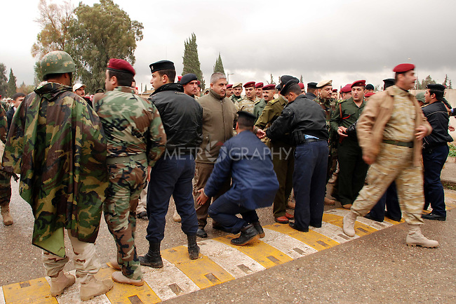 KIRKUK, IRAQ; Policemen vote in Kirkuk..Three days before the polls open, military and convicts vote in the Iraqi Parliamentary Elections....Photo by Hawre Khalid/ Metrography