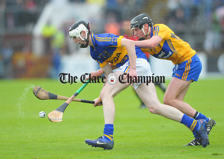 Thomas Hamill of Tipperary in action against Niall Deasy of Clare during the Munster minor hurling final at Pairc Ui Chaoimh. Photograph by John Kelly.