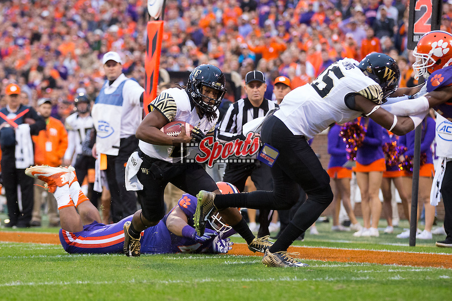 Kendall Hinton (2) of the Wake Forest Demon Deacons rushes for a touchdown during first half action against the Clemson Tigers at Memorial Stadium on November 21, 2015 in Clemson, South Carolina.  The Tigers defeated the Demon Deacons 33-13.   (Brian Westerholt/Sports On Film)