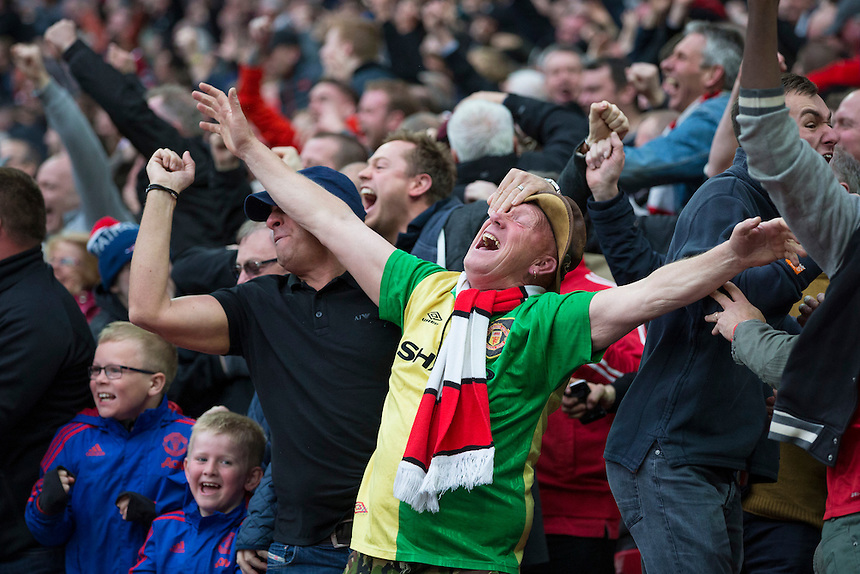 Manchester United fans celebrate their side's second and winning goal<br /> <br /> Photographer Craig Mercer/CameraSport<br /> <br /> Football - The FA Cup Semi Final - Everton v Manchester United - Saturday 23rd April 2016 - Wembley - London<br /> <br /> &copy; CameraSport - 43 Linden Ave. Countesthorpe. Leicester. England. LE8 5PG - Tel: +44 (0) 116 277 4147 - admin@camerasport.com - www.camerasport.com
