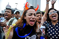 An Indian woman participates in a rally against the governments response to the terrorists attacks on Indias financial capital. 3rd of December 2008, Mumbai, India.