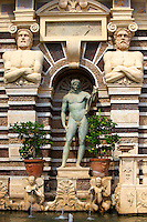 Statue of Appolo. The Organ fountain, 1566, housing organ pipies driven by air from the fountains. Villa d'Este, Tivoli, Italy - Unesco World Heritage Site.