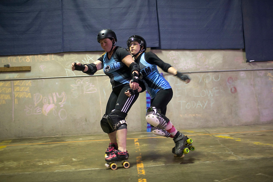 Dirty Ann (L) and Trouble Axle (R) of the Storm City Roller Girls spar during a practice in Vancouver Thursday February 9, 2017. (Photo by Natalie Behring for the Columbian)