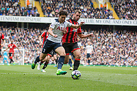Son Heung-Min of Tottenham Hotspur gets away from Steve Cook of Bournemouth during the Premier League match between Tottenham Hotspur and Bournemouth at White Hart Lane, London, England on 15 April 2017. Photo by Mark  Hawkins / PRiME Media Images.
