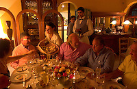 Waiters attend to patrons of the La Bourgogne restaurant in Punta del Este, Uruguay. The restaurant is considered the best in the country. The venerable South American beach resort is having a rennaisance. (Kevin Moloney for the New York Times)