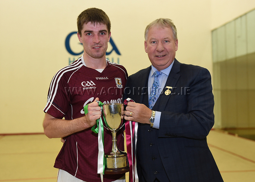 07/10/2017; Myclubshop.ie All-Ireland Handball 60x30 Championship, Men&rsquo;s Intermediate Singles Final - Martin Mulkerrins (Galway) vs JP O&rsquo;Connor (Limerick); GAA Handball Center, Croke Park, Dublin;<br /> GAA Handball President Joe Masterson presents the cup to Martin Mulkerrins of Galway.<br /> Photo Credit: actionshots.ie/Tommy Grealy