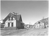 Dolores RGS depot with goose barn to right and grain elevator to far left.<br /> RGS  Dolores, CO  Taken by Chione, A. G. - 5/1951