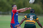 Suliasi Taufalele passes over the top of Pukekohe defender Manoa Lesavua. Counties Manukau Premier Club Rugby game between Ardmore Marist and Pukekohe, played at Bruce Pulman Park Papakura, on April 16th 2011..Ardmore Marist won 23 - 16 after leading 23 - 6 at halftime.