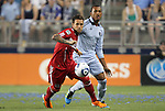 09 June 2011: Chicago's Daniel Paladini (left) and Kansas City's Teal Bunbury (right). Sporting Kansas City played the Chicago Fire to a 0-0 tie in the inaugural game at LIVESTRONG Sporting Park in Kansas City, Kansas in a 2011 regular season Major League Soccer game.