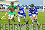 Cathal Keane of Crotta O'Neils races against Ardfert's Aaron Thompson and Iarla Courtney in the Feile na Gael blitz held last Saturday in Ballyduff.
