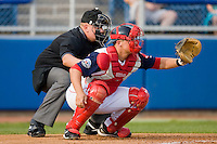 Home plate umpire Tyler Wilson gets down low behind Tim Federowicz #18 of the Salem Red Sox at Lewis-Gale Field May 1, 2010, in Winston-Salem, North Carolina.  Photo by Brian Westerholt / Four Seam Images
