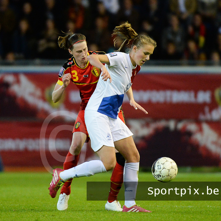 20140507 - LEUVEN , BELGIUM : Belgian Heleen Jaques (l) pictured with Dutch Vivianne Miedema (r) during the female soccer match between Belgium and The Netherlands, on the eighth matchday in group 5 of the UEFA qualifying round to the FIFA Women World Cup in Canada 2015 at Stadion Den Dreef , Leuven . Wednesday 7th May 2014 .  PHOTO DAVID CATRY