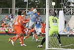 19 May 2012: Puerto Rico's Jonathan Fana (DOM) (in blue) chests the ball past Carolina's Ray Burse (18) to score the game's first goal. The Carolina RailHawks and the Puerto Rico Islanders played to a 1-1 tie at WakeMed Soccer Stadium in Cary, NC in a 2012 North American Soccer League (NASL) regular season game.