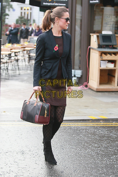 Pippa Middleton arrives for work,.London, England..November 9th, 2011.full length sunglasses shades black blazer brown skirt pattern tights bag purse boots poppy ponytail profile.CAP/HIL.©John Hillcoat/Capital Pictures .