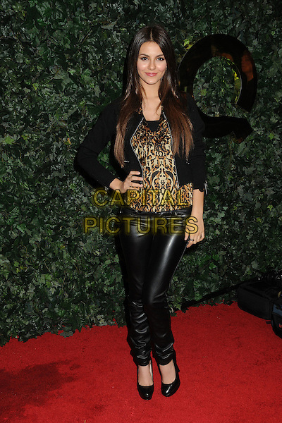 VICTORIA JUSTICE.QVC Red Carpet Style Party held at the Four Seasons Hotel, Beverly Hills, California, USA..February 25th, 2011.full length black leather trousers jacket brown beige leopard print top hand on hip.CAP/ADM/BP.©Byron Purvis/AdMedia/Capital Pictures.