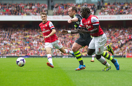 22.09.2013 London, England.  Charlie Adam of Stoke city takes on Bacary Sagna of Arsenal during the Premier League game between Arsenal and Stoke City from the Emirates Stadium.
