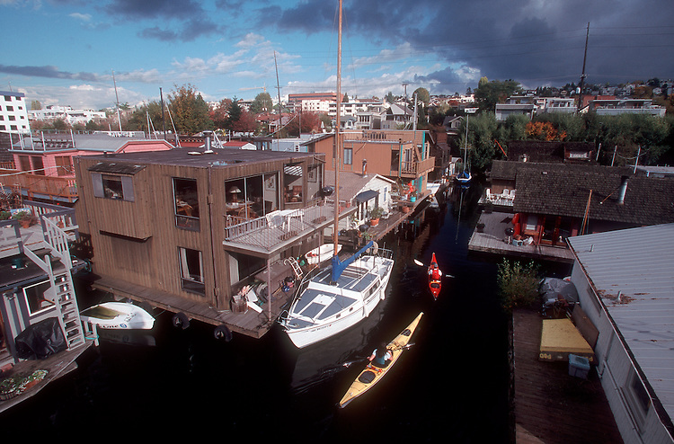 Seattle, Houseboats, kayakers explore the Fairview dock community, Lake Union, Washington State, Pacific Northwest, Tim Kelly, Chellie Terry, model released.