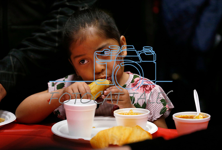 Nayeli Hernandez, 4, enjoys lunch at the La Posada Celebration at Western Nevada College, in Carson City, Nev., on Saturday, Dec. 15, 2018. <br /> Photo by Cathleen Allison/Nevada Momentum
