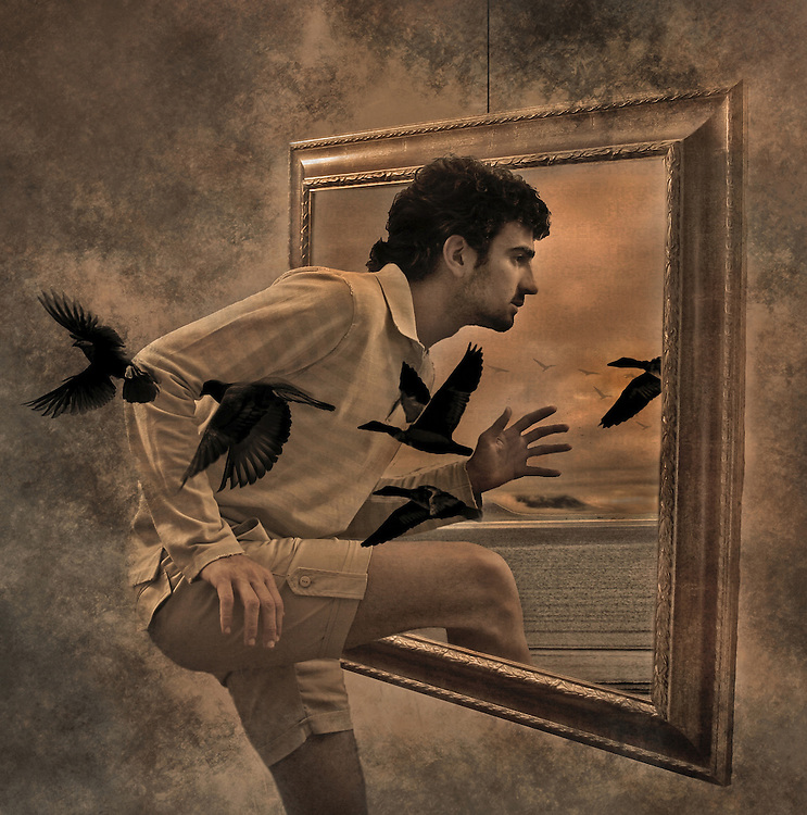 A young man escaping through a picture frame with black birds flying