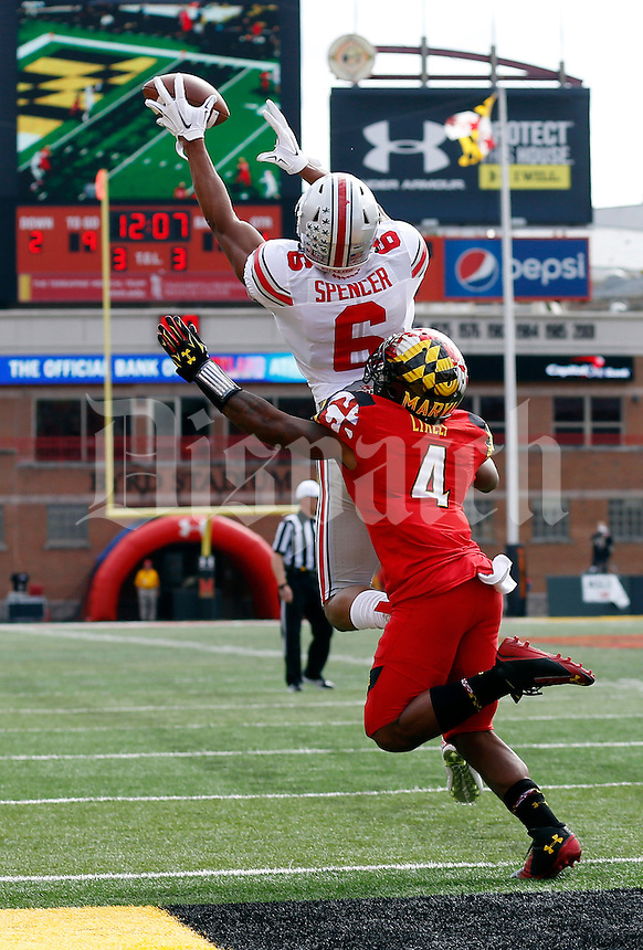 Ohio State Buckeyes wide receiver Evan Spencer (6) catches a ball just shy of the goal line over Maryland Terrapins defensive back William Likely (4) during the first quarter of the NCAA football game at Byrd Stadium in College Park, Maryland on Oct. 4, 2014. (Adam Cairns / The Columbus Dispatch)