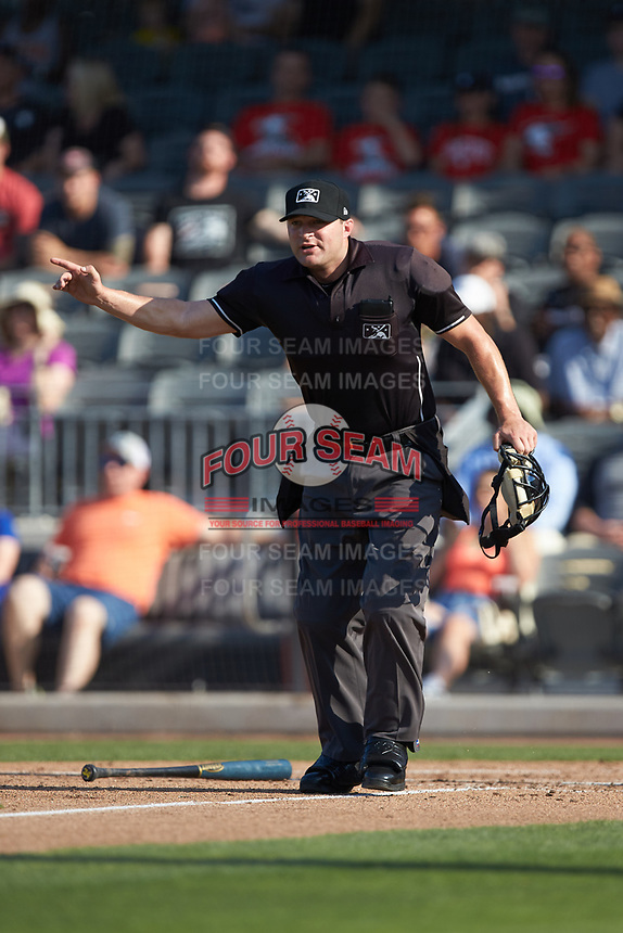 Home plate umpire Jake Bruner indicates a fair ball during the Carolina League game between the Carolina Mudcats and the Fayetteville Woodpeckers at SEGRA Stadium on May 18, 2019 in Fayetteville, North Carolina. The Mudcats defeated the Woodpeckers 6-4. (Brian Westerholt/Four Seam Images)