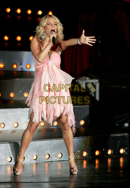 JESSICA SIMPSON.Performs live during her Reality Tour 2004 at The Pacific Ampitheatre in Costa Mesa, California .July 31,2004 .stage, music, concert, gig, singing, full length, pink dress, flowing, layered,  dancing.www.capitalpictures.com.sales@capitalpictures.com.Supplied By Capital Pictures