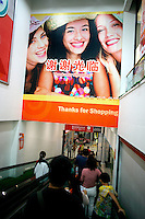 "A sign says ""Thank You For Shopping"" in both English and Chinese in the RT Mart supermarket in Nanjing, China."