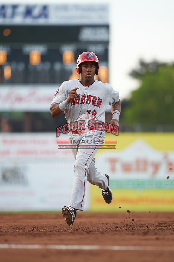Auburn Doubledays third baseman Omar Meregildo (18) takes third base on a passed ball during a game against the Batavia Muckdogs on July 6, 2017 at Dwyer Stadium in Batavia, New York.  Auburn defeated Batavia 4-3.  (Mike Janes/Four Seam Images)