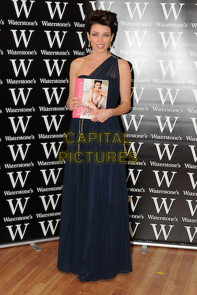 "Dannii Minogue signs copies of her new book ""My Style"" at Bluewater Shopping Centre, Greenhithe, Kent, England, UK..29th September 2011.full length black navy blue maxi one shoulder dress .CAP/BRC.©Ben Rector/Capital Pictures."