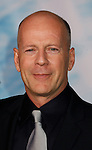 """HOLLYWOOD, CA. - September 24: Bruce Willis  arrives at the Los Angeles premiere of """"Surrogates"""" at the El Capitan Theatre on September 24, 2009 in Hollywood, California."""
