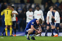 Luke McCormick of Chelsea shows his despair at the final whistle as Tottenham players celebrate their victory in the background during Chelsea Under-23 vs Tottenham Hotspur Under-23, Premier League 2 Football at Stamford Bridge on 13th April 2018