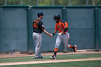 San Francisco Giants Orange first baseman Robinson Medrano (28) high fives coach Travis Ishikawa after hitting a home run during an Extended Spring Training game against the Oakland Athletics at the Lew Wolff Training Complex on May 29, 2018 in Mesa, Arizona. (Zachary Lucy/Four Seam Images)