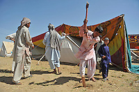 Workers put up large pieces of cloth to provide extra shade over the refugee tents. The temperature in the tents can go up to 50 degrees. The Pakistani government began an offensive against the Taliban in the Swat Valley in April 2009, which led to a major humanitarian crisis. Up to two million civilians were estimated to have been displaced by the fighting.