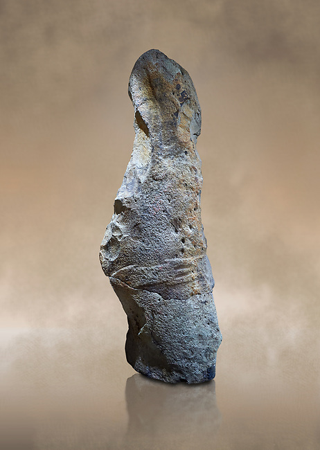 Late European Neolithic prehistoric Menhir standing stone with carvings on its face side. The remains of a representation of a stylalised male figure starts at the top with a long nose from which 2 eyebrows arch around the top of the stone. below this is a carving of a falling figure with head at the bottom and 2 curved arms encircling a body above. at the bottom is a carving of a dagger running horizontally across the menhir. the bottom is a carving of a dagger running horizontally across the menhir. Excavated from Piscina 'E Sali IV site,  Laconi.  Menhir Museum, Museo della Statuaria Prehistorica in Sardegna, Museum of Prehoistoric Sardinian Statues, Palazzo Aymerich, Laconi, Sardinia, Italy