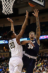 24 February 2016: Notre Dame's Zach Auguste (30) and Wake Forest's John Collins (20). The Wake Forest University Demon Deacons hosted the University of Notre Dame Fighting Irish at Lawrence Joel Veterans Memorial Coliseum in Winston-Salem, North Carolina in a 2015-16 NCAA Division I Men's Basketball game. Notre Dame won the game 69-58.