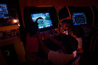 Acapulco, Mexico, February 17, 2012 – Young boys play a video game in an arcade in the community on the Bahia De Puerto Marquez.